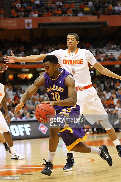 Mike Black of the Albany Great Danes takes the ball down the court against Michael CarterWilliams of the Syracuse Orange during the NIT Season Tipoff...