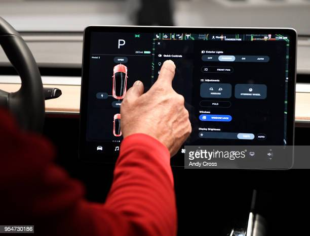Mike Blair gets handson experience with the Tesla Model 3's 15inch control touchscreen that has Wifi and LTE connectivity onboard maps and a...