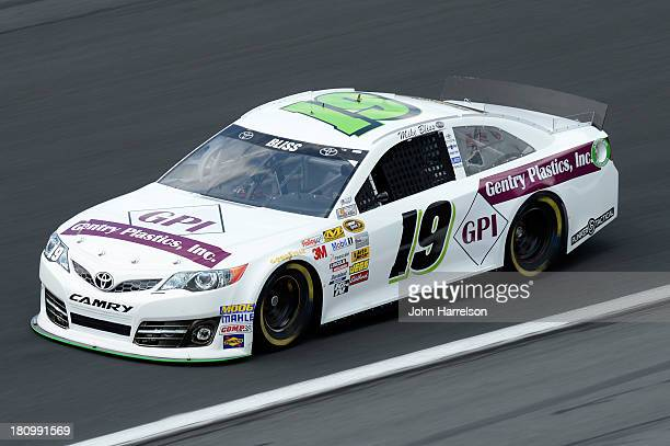 Mike Bliss driver of the Gentry Plastics / Plinker Tactical Toyota during practice for the NASCAR Sprint Cup Series CocaCola 600 at Charlotte Motor...