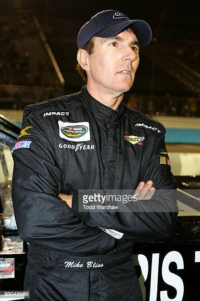Mike Bliss driver of the Harris Trucking Toyota waits by his truck before the NASCAR Camping World Truck Series Lucas Oil 150 at Phoenix...