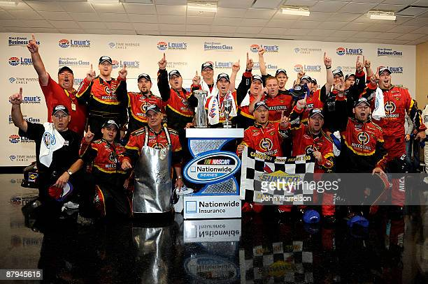 Mike Bliss driver of the Miccosukee Indian Gaming Resort Chevrolet celebrates with his crew after winning the NASCAR Nationwide Series CARQUEST Auto...