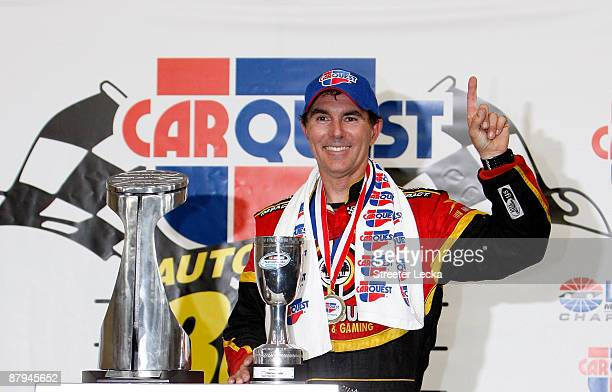 Mike Bliss driver of the Miccosukee Indian Gaming Resort Chevrolet poses in victory lane after winning the NASCAR Nationwide Series CARQUEST Auto...