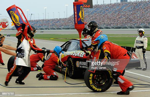 Mike Bliss driver of the Miccosukee Indian Gaming Resort Chevrolet pits during the NASCAR Nationwide Series Dollar General 300 at Chicagoland...