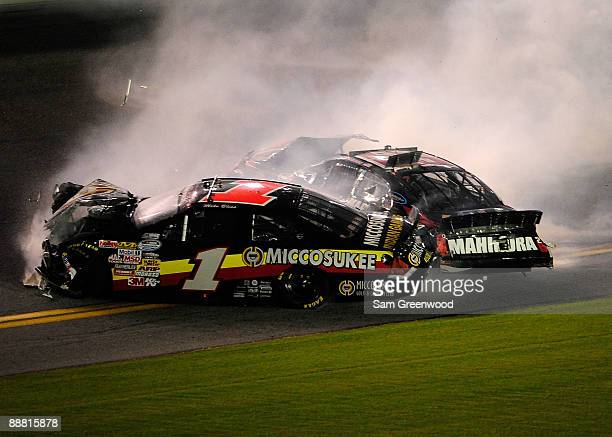 Mike Bliss driver of the Miccosukee Indian Gaming Resorts Chevrolet collides with Robert Richardson Jr driver of the Mahindra Tractors Chevrolet...