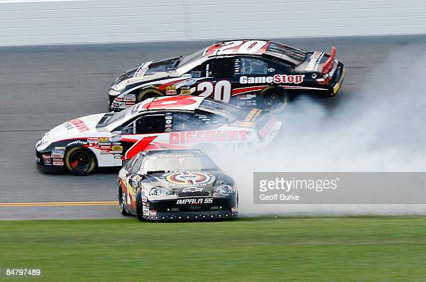 Mike Bliss driver of the Miccosukee Resorts Chevrolet spins as David Ragan driver of the Discount Tire Ford and Joey Logano driver of the GameStop...