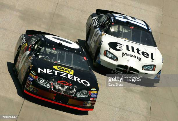 Mike Bliss driver of the Net Zero Best Buy Chevrolet car and Ryan Newman driver of the alltel Dodge car round turn 1 during the NASCAR Nextel Cup...