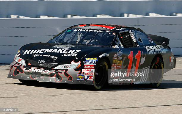 Mike Bliss driver of the Ridemakerz Toyota racing on the track during the NASCAR Nationwide series Kroger 'On Track For Cure' 250 race at the Memphis...