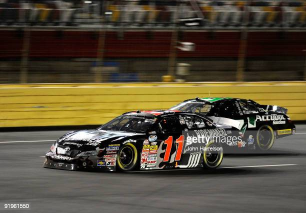 Mike Bliss driver of the Ridemakerzcom races with Dave Blaney driver of the AccuDoc Toyotaduring the NASCAR Nationwide Series Dollar General 300 at...