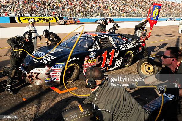 Mike Bliss driver of the Ridemakerzcom Toyota makes a pit stop during the NASCAR Nationwide Series Able Body Labor 200 at Phoenix International...