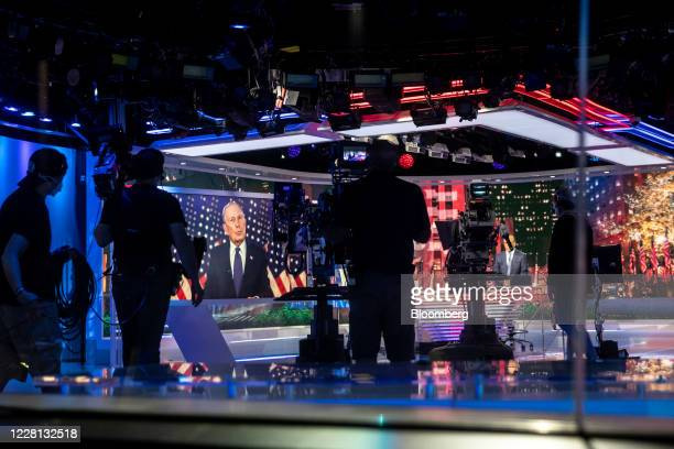 Mike Bloomberg, founder of Bloomberg LP, is displayed on a monitor at a television studio while speaking virtually during the Democratic National...