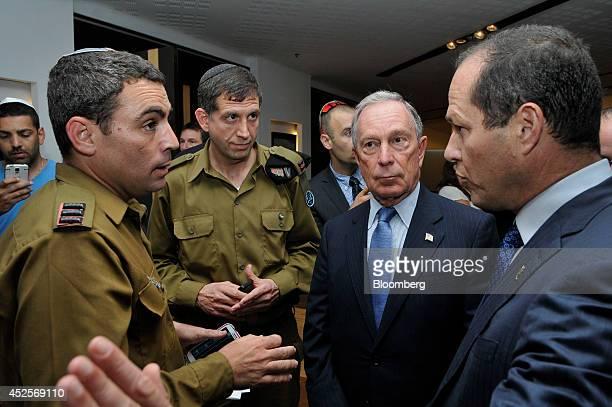 Mike Bloomberg, majority shareholder of Bloomberg LP and former New York mayor, second right, and Nir Barkat, mayor of Jerusalem, right, speak with...