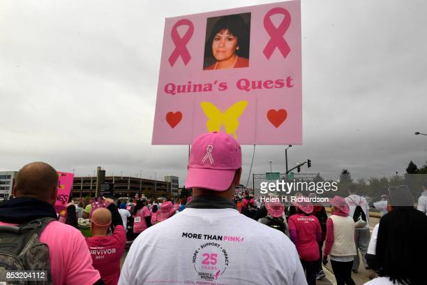 DENVER CO SEPTEMBER 24 Mike Boire of Littleton carries a sign for Viriginia 'Quina' Lacerte who died 9 years ago from breast cancer during the 25th...