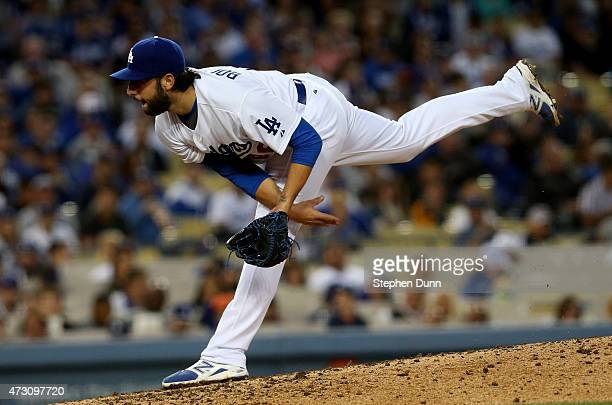 Mike Bolsinger of the Los Angeles Dodgers throws a pitch against the Miami Marlins at Dodger Stadium on May 12 2015 in Los Angeles California