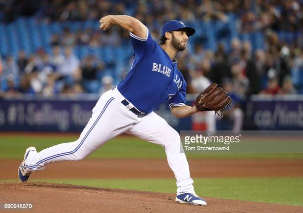 Mike Bolsinger of the Toronto Blue Jays delivers a pitch in the first inning during MLB game action against the Cincinnati Reds at Rogers Centre on...
