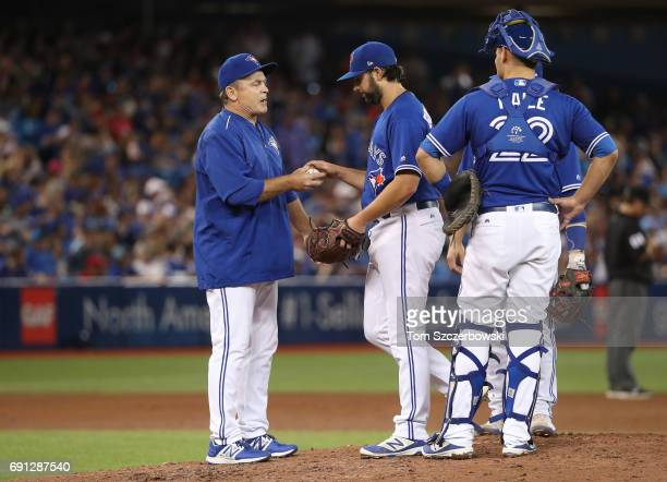 Mike Bolsinger of the Toronto Blue Jays exits the game as he is relieved by manager John Gibbons in the sixth inning during MLB game action against...