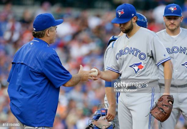 Mike Bolsinger of the Toronto Blue Jays is pulled from the game by manager John Gibbons of the Toronto Blue Jays during the sixth inning at Comerica...