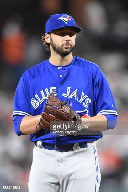 Mike Bolsinger of the Toronto Blue Jays pitches during a baseball game against the Baltimore Orioles at Oriole Park at Camden Yards on May 20 2017 in...
