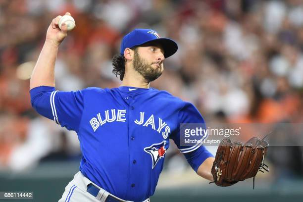 Mike Bolsinger of the Toronto Blue Jays pitches in the first inning during a baseball game against the Baltimore Orioles at Oriole Park at Camden...