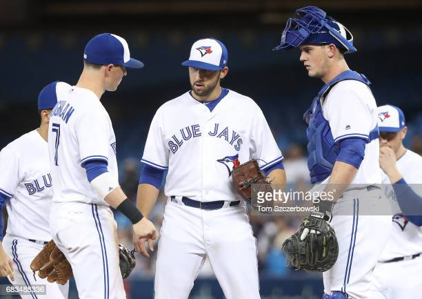 Mike Bolsinger of the Toronto Blue Jays stands on the mound talking to Chris Coghlan moments before exiting the game in the fifth inning during MLB...