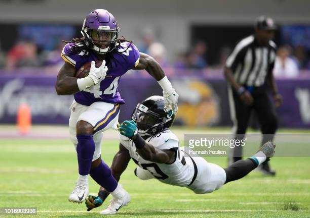 Mike Boone of the Minnesota Vikings avoids a tackle by Telvin Smith of the Jacksonville Jaguars during the second quarter in the preseason game on...