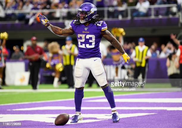 Mike Boone of the Minnesota Vikings celebrates after scoring a touchdown in the fourth quarter of the game against the Chicago Bears at U.S. Bank...
