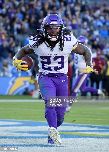 Mike Boone of the Minnesota Vikings reacts to his touchdown to take a 39-10 lead over the Los Angeles Chargers during the fourth quarter at Dignity...