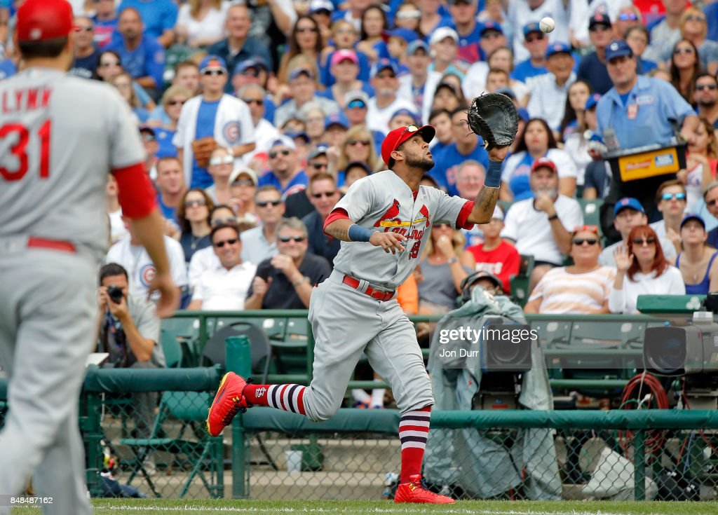 Mike Borzello #58 of the Chicago Cubs makes a catch for an out in foul territory on a ball hit by Anthony Rizzo #44 of the Chicago Cubs for the final out of the first inning at Wrigley Field on September 17, 2017 in Chicago, Illinois.