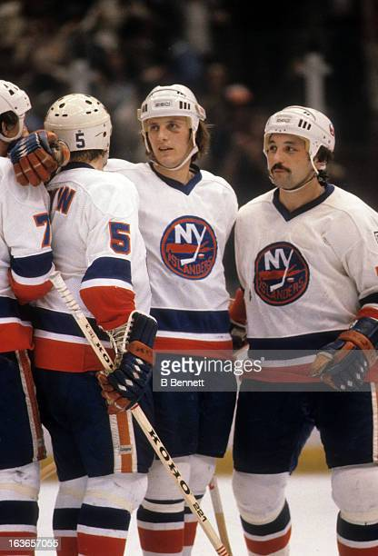 Mike Bossy Bryan Trottier Denis Potvin and Stefan Persson of the New York Islanders celebrate during an NHL game in 1980 at the Nassau Coliseum in...