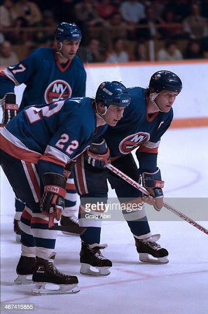 Mike Bossy Denis Potvin and John Tonelli of the New York Islanders prepare for the faceoff against the Toronto Maple Leafs during game action on...