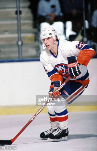 Mike Bossy of the New York Islanders skates with the puck during an NHL game circa January 1985 at the Nassau Coliseum in Uniondale New York