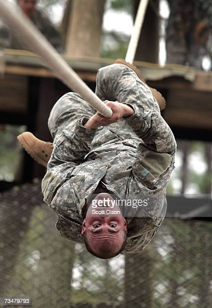 Mike Bowen of Hudson New Hampshire works his way down a rope on a confidence course during Army basic training at Fort Jackson March 1 2007 in...