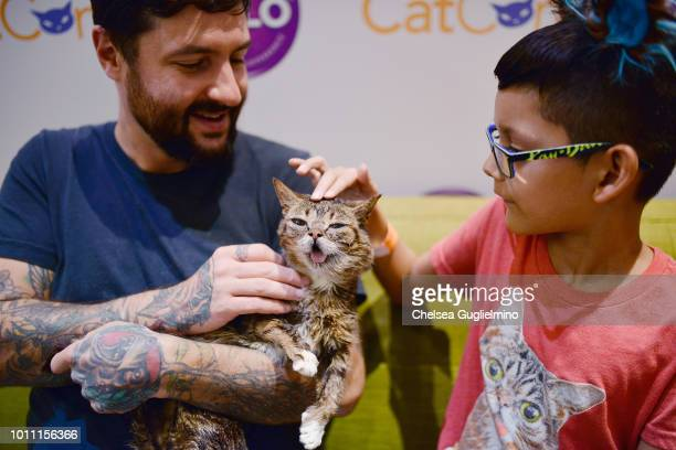 Mike Bridavsky and Lil Bub meet a fan at CatCon Worldwide 2018 at Pasadena Convention Center on August 4 2018 in Pasadena California