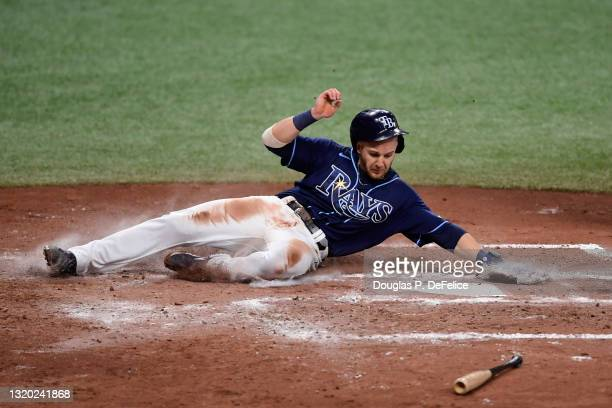 Mike Brosseau of the Tampa Bay Rays scores on a RBI single from Mike Zunino during the fourth inning against the Kansas City Royals at Tropicana...