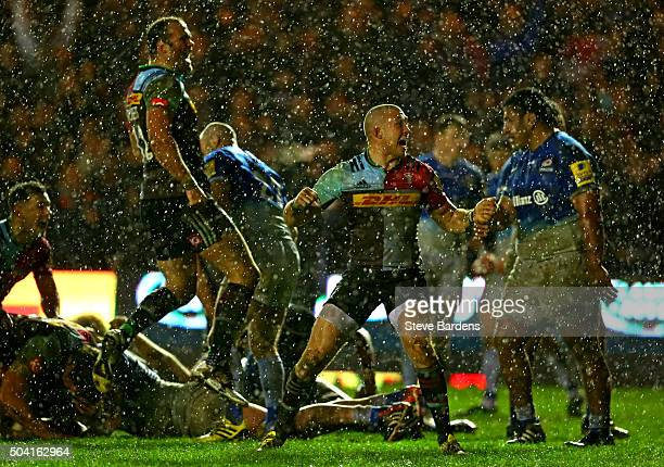 Mike Brown and Jamie Roberts of Harlequins celebrate after James Horwill of Harlequins scores a try late in the match during the Aviva Premiership...