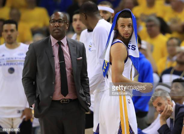 Mike Brown and Stephen Curry of the Golden State Warriors look on from the sideline against the Cleveland Cavaliers in Game 1 of the 2017 NBA Finals...
