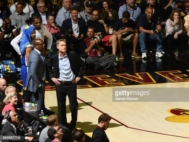 Mike Brown and Steve Kerr of the Golden State Warriors look on during the game against the Cleveland Cavaliers in Game Three of the 2017 NBA Finals...