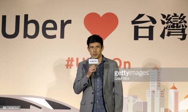 Mike Brown general manger of Uber's AsiaPacific region speaks during a press conference in Taipei on April 13 2017 Uber relaunched its ridehailing...