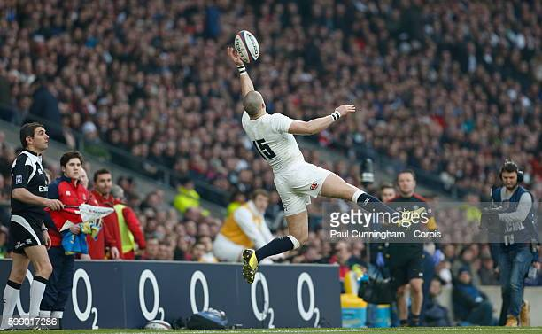 Mike Brown leaps sideways into the air to stop the ball from going into touch during the RBS 6 Nations match between England v Wales at Twickenham...