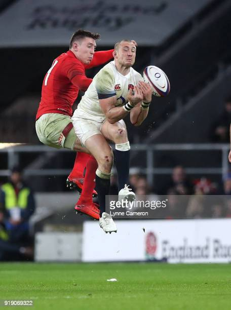 Mike Brown of England and Josh Adams of Wales during the NatWest Six Nations match between England and Wales at Twickenham Stadium on February 10...