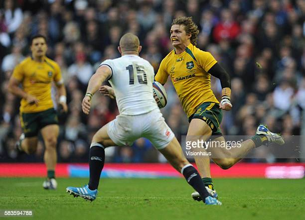 Mike Brown of England and Nick Cummins of Australia during the QBE international match between England and Australia at Twickenham Stadium in London...