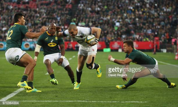 Mike Brown of England beats Damian de Allende Bongi Mbonambi and Handre Pollard of South Africa as he scores their first try during the first test...