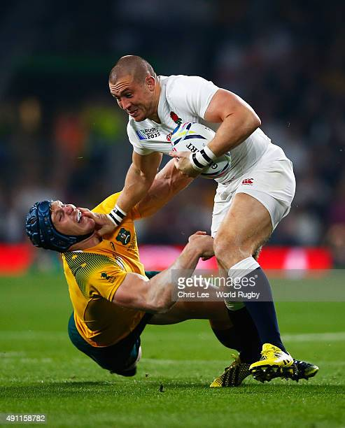 Mike Brown of England breaks the tackle of David Pocock of Australia during the 2015 Rugby World Cup Pool A match between England and Australia at...