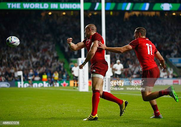 Mike Brown of England celebrates scoring their second try with Jonny May of England during the 2015 Rugby World Cup Pool A match between England and...