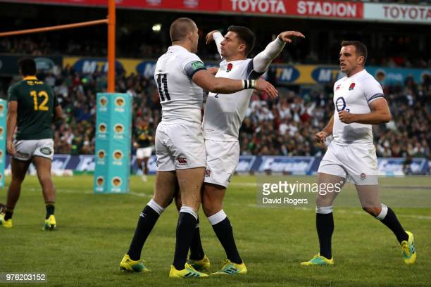 Mike Brown of England celebrates with team mate Ben Youngs after he scores the opening try of the match during the second test match between South...