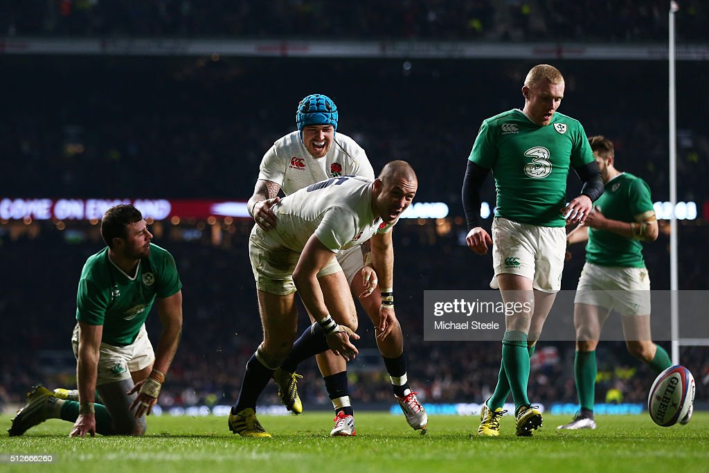 Mike Brown of England celebrates with teammate Jack Nowell of England after scoring his team's second try during the RBS Six Nations match between England and Ireland at Twickenham Stadium on February 27, 2016 in London, England.