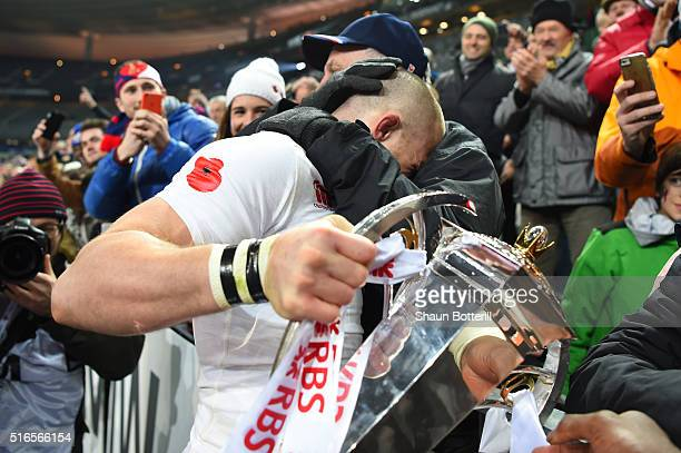 Mike Brown of England celebrates with the trophy following his team's 3121 victory during the RBS Six Nations match between France and England at the...