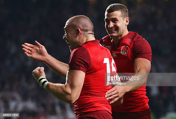 Mike Brown of England cleebrates scoring their second try with Jonny May of England during the 2015 Rugby World Cup Pool A match between England and...