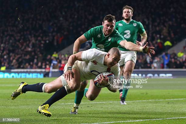 Mike Brown of England dives over to score his team's second try during the RBS Six Nations match between England and Ireland at Twickenham Stadium on...