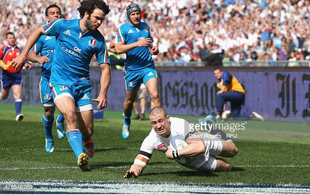 Mike Brown of England dives over to score the first try during the RBS Six Nations match between Italy and England at the Stadio Olimpico on March 15...