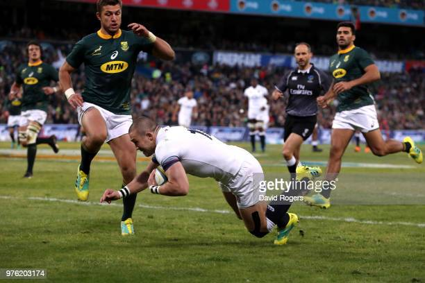 Mike Brown of England dives over to score the opening try during the second test match between South Africa and England on June 16 2018 in...